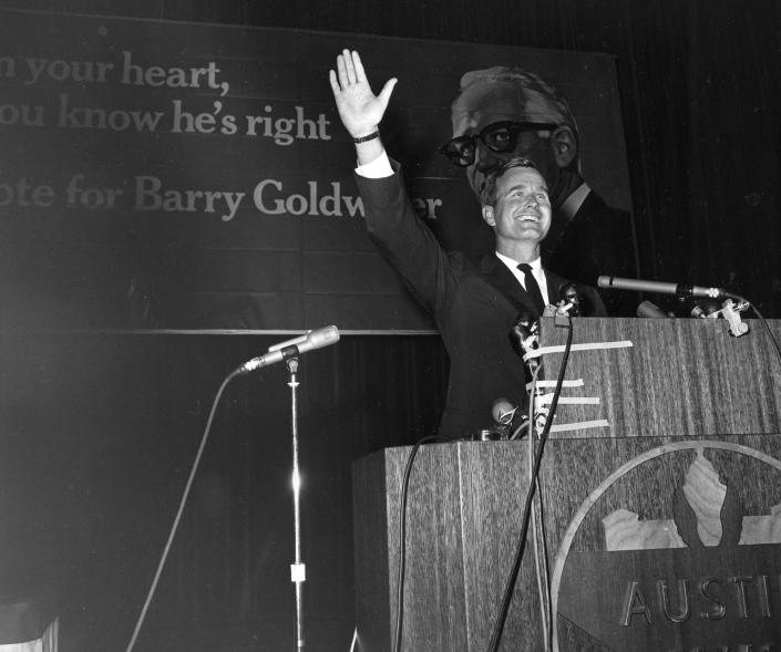 <p>George Bush of Houston, Republican candidate for the U.S. Senate, waves to cheering supporters after he addressed the Republican State Convention in Austin, Texas, on Sept. 15, 1964. Bush was running for the seat held by Sen. Ralph Yarborough. (Photo: AP) </p>