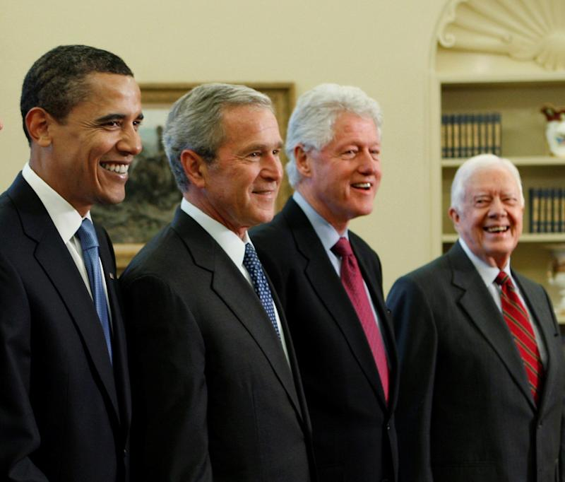 Former Presidents Barack Obama, George W. Bush, Bill Clinton, and Jimmy Carter on January 7, 2009, in the Oval Office of the White House in Washington.