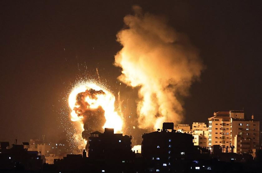 TOPSHOT - A picture shows Israeli air strikes in the Gaza Strip, controlled by the Palestinian Islamist movement Hamas, on May 10, 2021. - Israel launched deadly air strikes on Gaza in response to a barrage of rockets fired by the Islamist movement Hamas amid spiralling violence sparked by unrest at Jerusalem's Al-Aqsa Mosque compound. (Photo by MAHMUD HAMS / AFP) (Photo by MAHMUD HAMS/AFP via Getty Images)