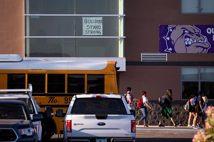 Students return to school on Aug. 17, 2020, at Queen Creek High School in Queen Creek. The Queen Creek Unified School District reopened all of its schools for in-person classes.