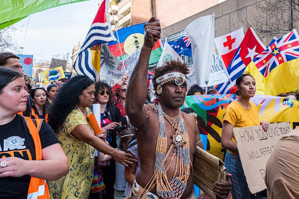 A man wearing the traditional dress of the Solomon Islands march on September 20, 2019 in Melbourne, Australia. (Photo: Asanka Ratnayake/Getty Images)
