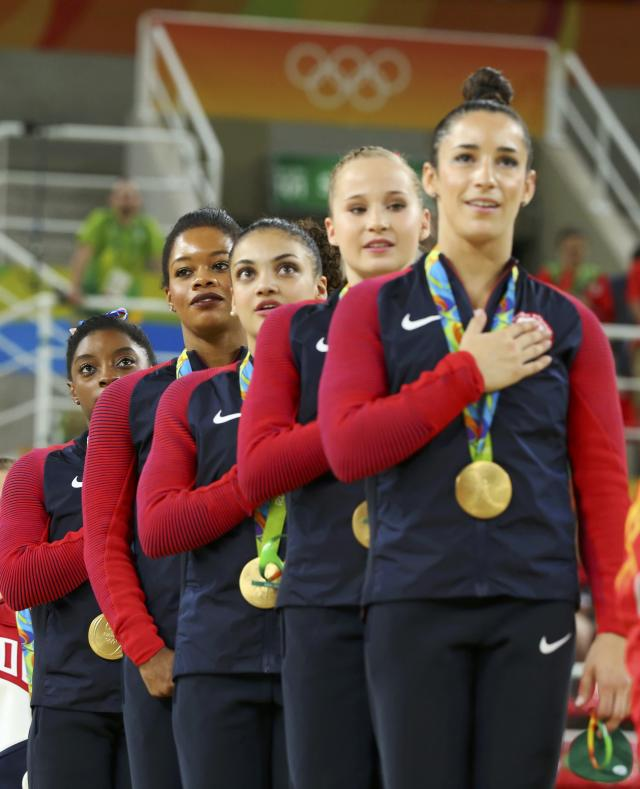 2016 Rio Olympics - Artistic Gymnastics - Final - Women's Team Victory Ceremony - Rio Olympic Arena - Rio de Janeiro, Brazil - 09/08/2016. (L-R) Simone Biles (USA) of USA, Gabrielle Douglas (USA) of USA (Gabby Douglas), Laurie Hernandez (USA) of USA, Madison Kocian (USA) of USA, Alexandra Raisman (USA) of USA (Aly Raisman) sing their national anthem with their gold medals on the podium after winning the women's team final. REUTERS/Mike Blake FOR EDITORIAL USE ONLY. NOT FOR SALE FOR MARKETING OR ADVERTISING CAMPAIGNS.