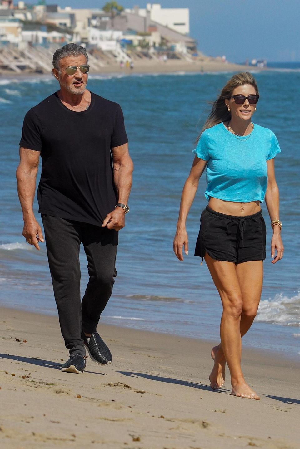 <p>Sylvester Stallone and his wife Jennifer Flavin enjoyed a walk on the beach in Malibu.</p>