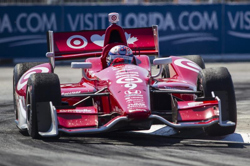 Scott Dixon, of New Zealand, takes a turn on his way to winning the Toronto Indy race in Toronto on Sunday, July 14, 2013. (AP Photo/The Canadian Press, Chris Young)