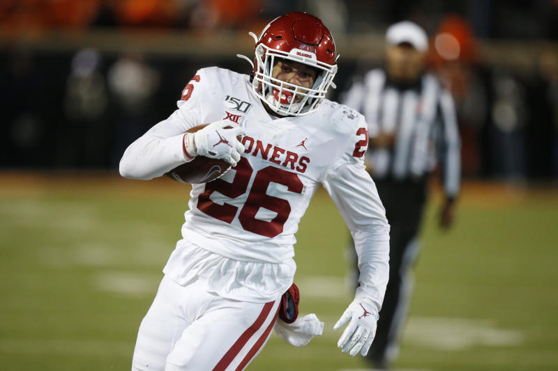 Oklahoma running back Kennedy Brooks (26) carries during an NCAA college football game against Oklahoma State in Stillwater, Okla., Saturday, Nov. 30, 2019. (AP Photo/Sue Ogrocki)