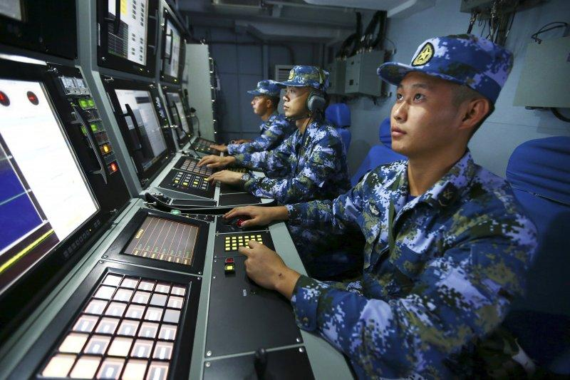 "The People's Liberation Army Navy's South Navy, the missile destroyer ""Hefei Ship"" officers and men looking for targets (AP)"