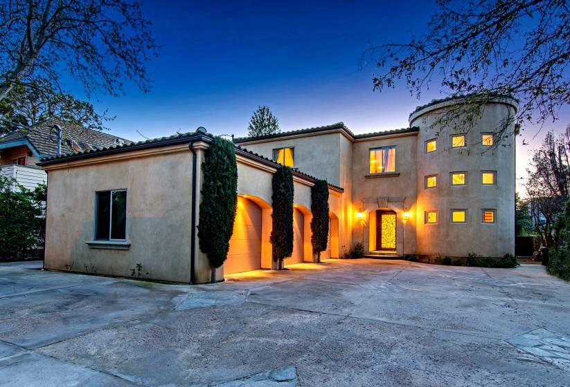 The half-acre spread includes a Mediterranean-style home, a swimming pool and a guesthouse at the far end of the property.