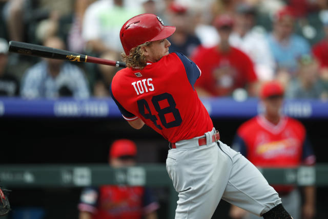St. Louis Cardinals' Harrison Bader follows the flight of his RBI-double off Colorado Rockies starting pitcher Tyler Anderson in the first inning of a baseball game Sunday, Aug. 26, 2018, in Denver. (AP Photo/David Zalubowski)