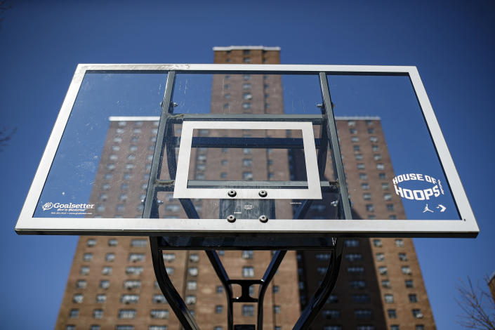 Basketball backboards stand without hoops after city officials had them removed to reduce gatherings at Holcombe Rucker Park, Thursday, March 26, 2020, in New York. Across the U.S., police departments are taking a lead role in enforcing social distancing rules that health officials say are critical to containing the coronavirus. In New York City, they've started dismantling basketball hoops to prevent people from gathering in parks and playing. (AP Photo/John Minchillo)