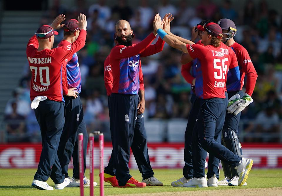 Moeen Ali (centre) celebrates taking the wicket of Fakhar Zaman (PA Wire)