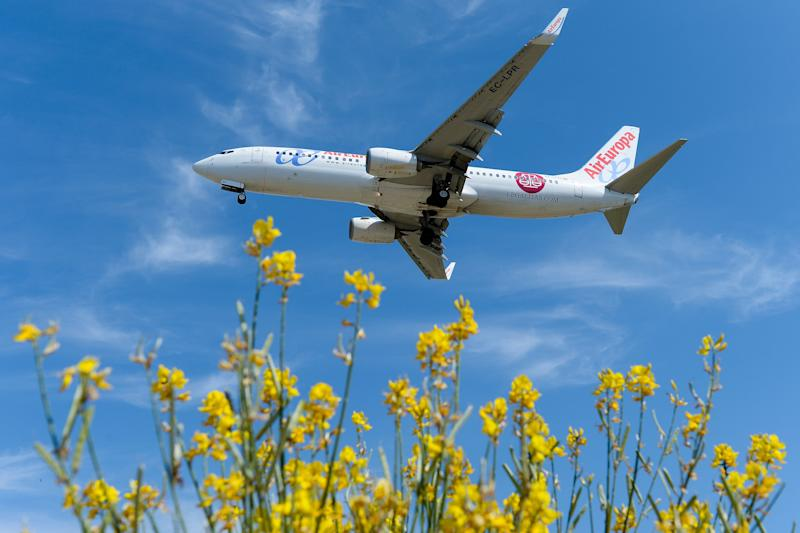 An airplane of the Spanish low-cost airline Air Europa prepares to land at Barcelona's airport in El Prat de Llobregat on June 6, 2016. / AFP / JOSEP LAGO (Photo credit should read JOSEP LAGO/AFP via Getty Images)