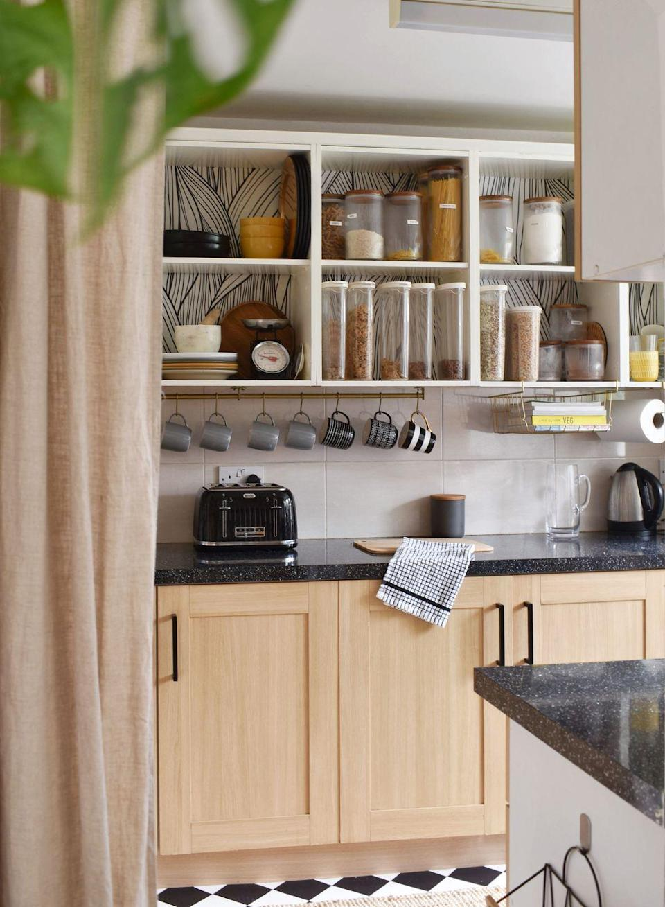 """<p>""""I removed the doors from my top cabinets to create an open shelving feel. I applied removable wallpaper to the backing of the cabinets to add a little character. The fact that I've been able to display my favourite kitchen accessories and dishware has given the space a little more personality.""""</p>"""