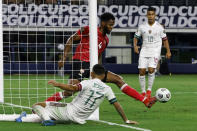 Trinidad and Tobago defender Jelani Peters (4) defends a shot on goal in front of Mexico forward Jesus Corona (17) during the first half of a CONCACAF Gold Cup Group A soccer match in Arlington, Texas, Saturday, July 10, 2021. (AP Photo/Michael Ainsworth)