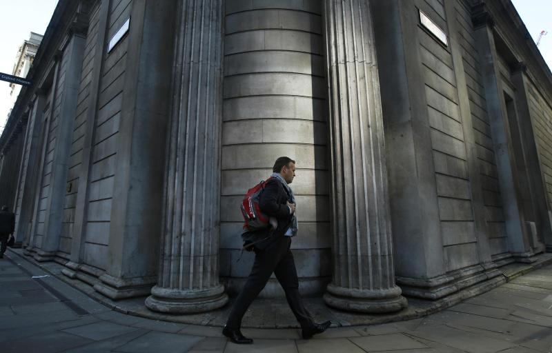 A man passes the Bank of England in the City of London