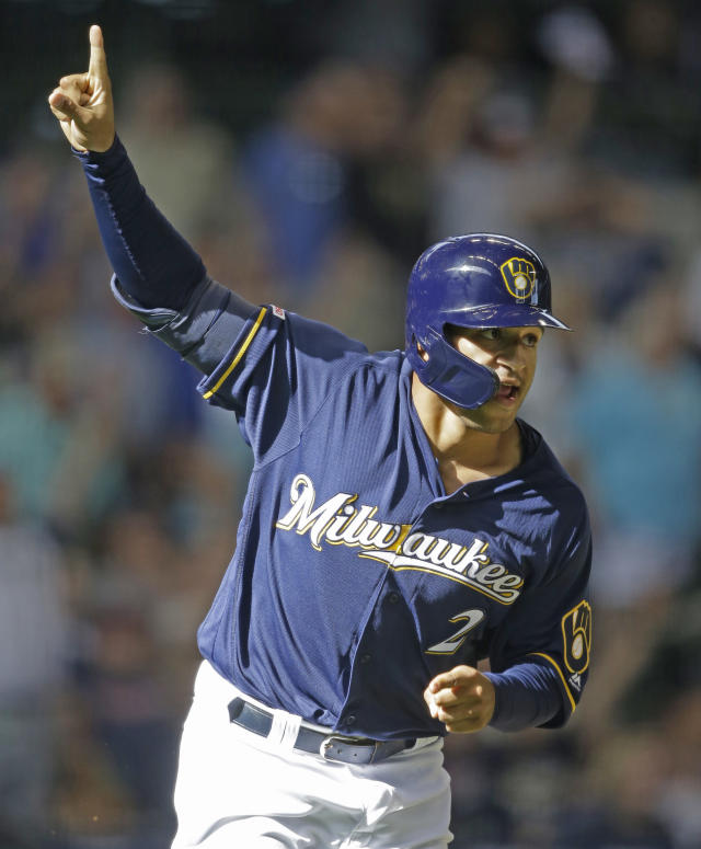 Milwaukee Brewers' Trent Grisham reacts to his three-run home run against the Minnesota Twins during the eighth inning of a baseball game Wednesday, Aug. 14, 2019, in Milwaukee. (AP Photo/Jeffrey Phelps)