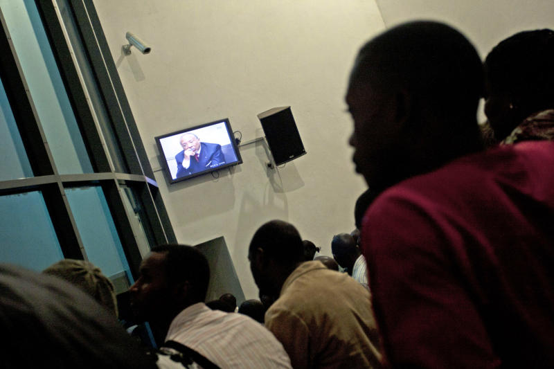 People watch a live broadcast of the verdict in the Netherlands-based trial of former Liberian president Charles Taylor, at the Special Court for Sierra Leone, in Freetown, Sierra Leone Thursday, April 26, 2012. Thousands of people who survived Sierra Leone's brutal civil war a decade ago celebrated Thursday after learning that Taylor had been convicted for his role in the conflict that left behind countless amputees and traumatized former child soldiers. (AP Photo/Felicity Thompson)