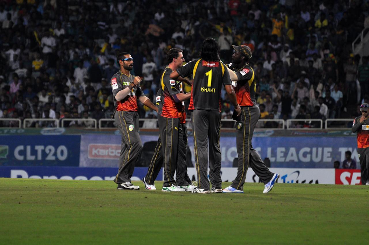 Players of Sunrisers Hyderabad celebrates after taking wicket during match against Titans at Karbonn Smart Champions League Twenty-20 Match at Jharkhand State Cricket Association (JSCA) International Cricket Stadium in Ranchi on 28 Sept. 2013. (Photo: IANS)