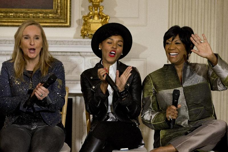 "Singers Melissa Etheridge, left, and Janelle Monáe, applaud Patti LaBelle, right, as she is introduced in the State Dining Room of the White House Washington, Thursday, March 6, 2014, during a workshop for students as part of the ""In Performance at the White House"" series, celebrating female artists as the ""foremothers"" of American music, hosted by first lady Michelle Obama. (AP Photo/Jacquelyn Martin)"
