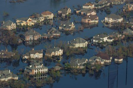Neighborhoods are flooded with oil and water two weeks after Hurricane Katrina went though New Orleans