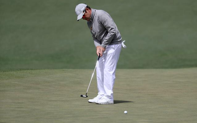 <span>Louis Oosthuizen of South Africa putts on the second green</span> <span>Credit: Rob Carr/Getty Images </span>
