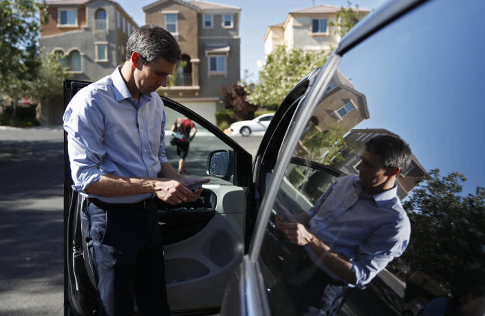 """Democratic presidential candidate and former Texas Congressman Beto O'Rourke looks at his phone before driving away after a Service Employees International Union """"Walk A Day In the Shoes"""" event, Thursday, Aug. 1, 2019, in Las Vegas. (AP Photo/John Locher)"""