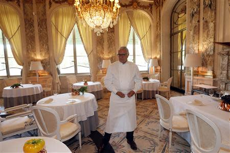 French chef Alain Ducasse poses in the dining room at the Le Meurice Restaurant in Paris September 4, 2013. REUTERS/Charles Platiau