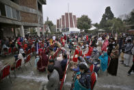 Christians, wearing face masks, attend a Christmas mass in Our Lady of Fatima Church in Islamabad, Pakistan, Friday, Dec. 25, 2020. (AP Photo/Anjum Naveed)