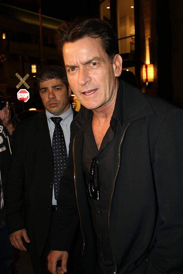 "Charlie Sheen came clad in black for ""Anger Management's"" wrap party, held at Mixology 101 in Los Angeles. Now that the first season of his FX show (loosely based on the 2003 Jack Nicholson movie of the same name) is done taping, the 46-year-old actor told ""Extra"" that he is looking forward to a summer of hanging out ""at soccer games, t-ball games, and barbecues ... just be a dad, you know? I haven't been able to do that for a long time."" (5/3/2012)"
