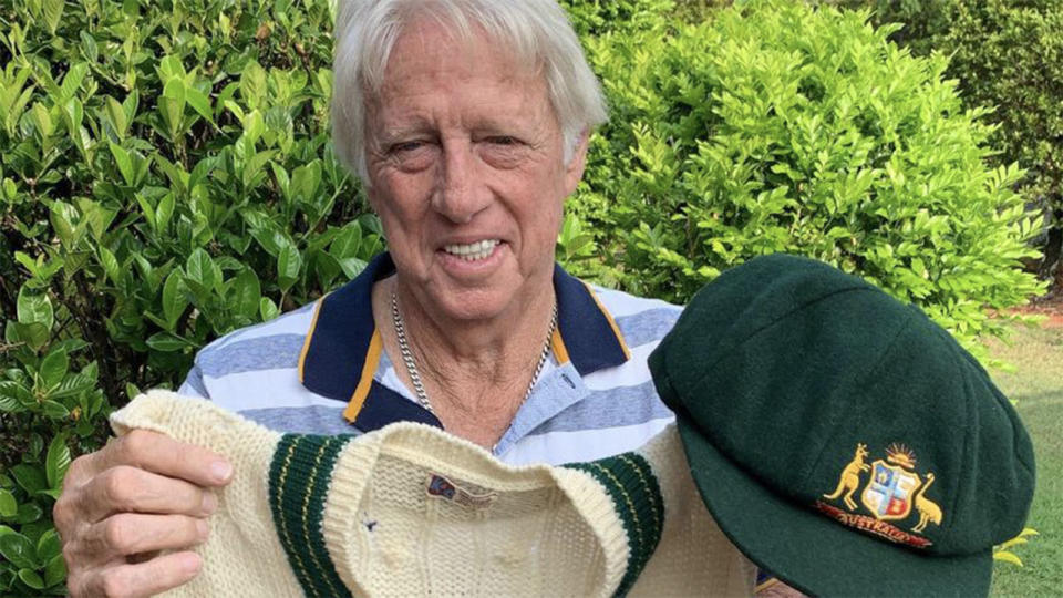 Jeff Thomson holding his baggy green and his vest, which he will sell to aid the bushfire relief appeal.