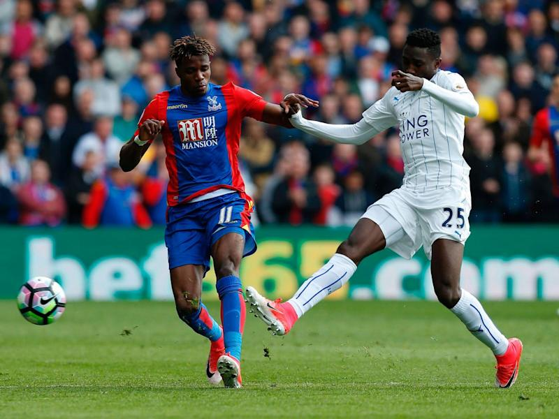 Wilfried Zaha vies with Wilfred Ndidi for possession (Getty)