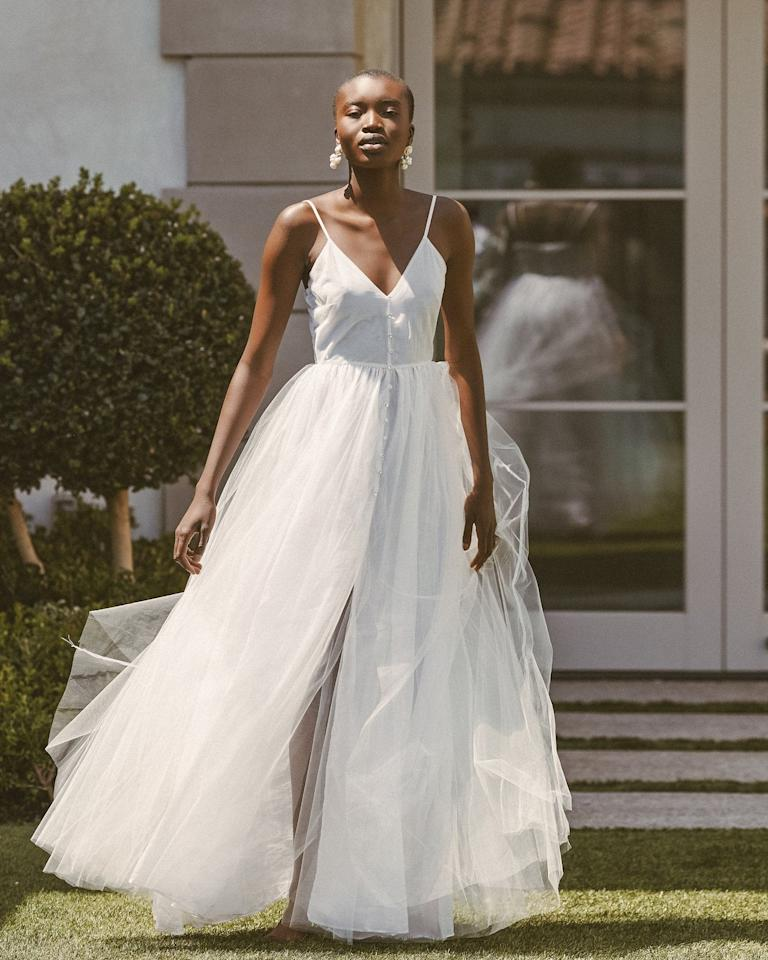 """<p>This <a href=""""https://www.popsugar.com/buy/Lurelly-Lotus-Gown-582285?p_name=Lurelly%20Lotus%20Gown&retailer=lurelly.com&pid=582285&price=700&evar1=fab%3Aus&evar9=47551973&evar98=https%3A%2F%2Fwww.popsugar.com%2Fphoto-gallery%2F47551973%2Fimage%2F47552338%2FLurelly-Lotus-Gown&list1=shopping%2Cwedding%2Cbride%2Cwedding%20dresses%2Cfashion%20shopping%2Cbest%20of%202020&prop13=api&pdata=1"""" rel=""""nofollow"""" data-shoppable-link=""""1"""" target=""""_blank"""" class=""""ga-track"""" data-ga-category=""""Related"""" data-ga-label=""""https://lurelly.com/products/lotus-gown"""" data-ga-action=""""In-Line Links"""">Lurelly Lotus Gown</a> ($700) includes little diamond buttons down the front.</p>"""