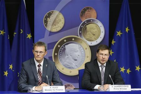 Latvia's PM Dombrovskis and FM Vilks address a news conference on the adoption of the euro by Latvia at the EU council building in Brussels