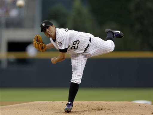Colorado Rockies starting pitcher Jorge De La Rosa throws in the first inning of a baseball game against the Washington Nationals on Wednesday, June 12, 2013, in Denver. (AP Photo/Joe Mahoney)
