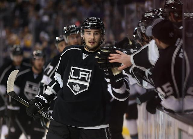 LOS ANGELES, CA - MAY 14: Slava Voynov #26 of the Los Angeles Kings receives high fives from the bench after scoring a goal against the San Jose Sharks in the first period of Game One of the Western Conference Semifinals during the 2013 NHL Stanley Cup Playoffs at Staples Center on May 14, 2013 in Los Angeles, California. (Photo by Jeff Gross/Getty Images)