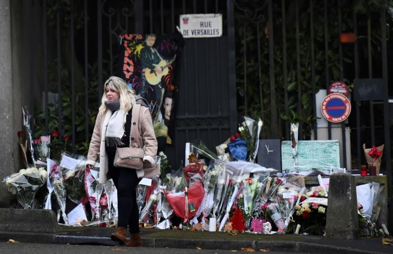 Fans deposed flowers outside the home of French rocker Johnny Hallyday in Marnes-la-Coquette, outside Paris, on Thursday