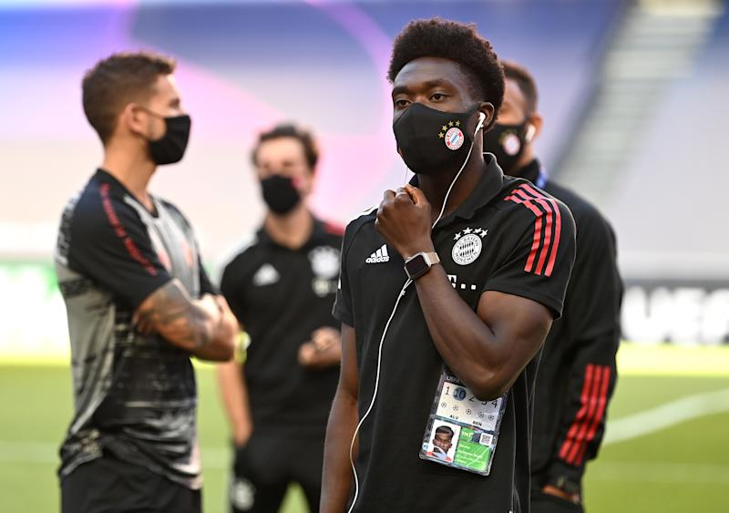 LISBON, PORTUGAL - AUGUST 23: Alphonso Davies of FC Bayern Munich looks on during a pitch inspection prior to the UEFA Champions League Final match between Paris Saint-Germain and Bayern Munich at Estadio do Sport Lisboa e Benfica on August 23, 2020 in Lisbon, Portugal. (Photo by Michael Regan - UEFA/UEFA via Getty Images)