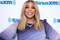 "The talk show host is no longer on the market. After her turbulent split from estranged husband <a href=""https://people.com/tv/kevin-hunter-believes-wendy-williams-turning-son-against-him/"" rel=""nofollow noopener"" target=""_blank"" data-ylk=""slk:Kevin Hunter"" class=""link rapid-noclick-resp"">Kevin Hunter</a>, Williams made herself a Hot Topic of the day by revealing she's ""crazy about"" a mystery man who happens to be a doctor. ""You all think I'm messing around with a 27-year-old — 27-year-old boys, quite frankly, do find me very attractive. I get it,"" she said to her audience, seemingly referencing her fling with a <a href=""https://people.com/tv/wendy-williams-mystery-man-identified-convicted-felon/"" rel=""nofollow noopener"" target=""_blank"" data-ylk=""slk:27-year-old convicted felon"" class=""link rapid-noclick-resp"">27-year-old convicted felon</a> named Marc Tomblin. ""But when it comes time for the comfort of a man, I need somebody in his 50s, too. And he's got to work."" With that, Williams gave a sly smile before sharing a few more details about her new man. ""It helps that he's a doctor,"" she said as the audience began cheering wildly. ""I am not going to say one more word. You're not going to blow this for me. But he's been married, his kids are in their 20s. And yes, he's black. I know you're wondering."" Williams <a href=""https://people.com/tv/wendy-williams-husband-kevin-hunter-split/"" rel=""nofollow noopener"" target=""_blank"" data-ylk=""slk:filed for divorce"" class=""link rapid-noclick-resp"">filed for divorce</a> from Hunter in April after more than two decades of marriage, and also cut ties with him professionally, as he was <a href=""https://people.com/tv/wendy-williams-drops-husband-kevin-hunter-executive-producer/"" rel=""nofollow noopener"" target=""_blank"" data-ylk=""slk:removed as executive producer"" class=""link rapid-noclick-resp"">removed as executive producer</a> of <em>The Wendy Williams Show</em> one week after their split."