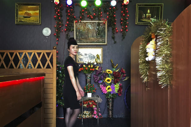 "<p>A waitress walks past the decorated interiors of a ""soft drink shop"" located at the Kim Il Sung Square in Pyongyang, North Korea on June 18, 2017. (Photo: Wong Maye-E/AP) </p>"