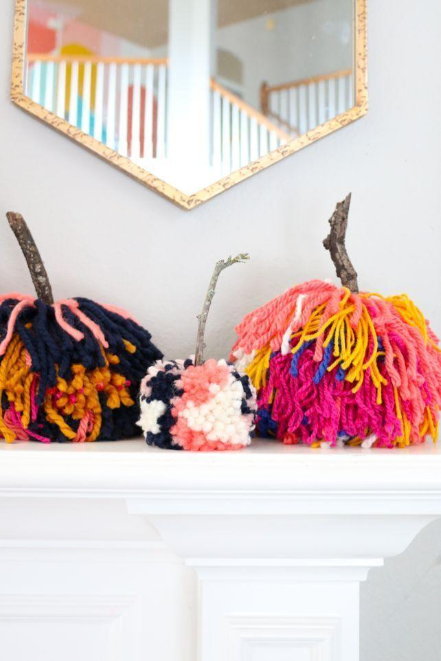 "<p>No carving required: Make your own Halloween decorations with this kid-safe craft, made entirely out of colored yarn cut to mimic a pom pom's shape. </p><p><em><a href=""https://akailochiclife.com/2018/09/diy-large-pom-pom-pumpkins.html"" rel=""nofollow noopener"" target=""_blank"" data-ylk=""slk:Get the tutorial at A Kailo Chic Life »"" class=""link rapid-noclick-resp"">Get the tutorial at A Kailo Chic Life »</a></em></p>"