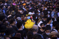 Inflatable yellow ducks, which have become a good-humored symbol of resistance during anti-government rallies, are held by a protester during a rally Wednesday, Nov. 25, 2020 in Bangkok, Thailand. Pro-democracy demonstrators in Thailand on Wednesday again took to the streets of the capital, even as the government escalated its legal battle against them, reviving the use of a harsh law against defaming the monarchy. (AP Photo/Wason Wanichakorn)