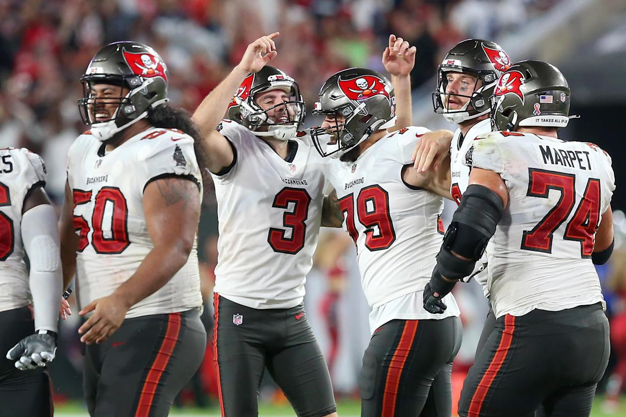 TAMPA, FL - SEPTEMBER 09: Tampa Bay Buccaneers Place Kicker Ryan Succop (3) points skywards as he team mates congratulte him after Succup successfully kicked the game winning field goal in the last seconds of the regular season game between the Dallas Cowboys and the Tampa Bay Buccaneers on September 09, 2021 at Raymond James Stadium in Tampa, Florida. (Photo by Cliff Welch/Icon Sportswire via Getty Images)