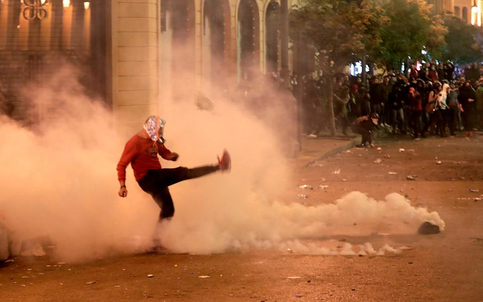 Demonstrators clashed with police during anti-government protests in December 2019 - ANWAR AMRO/AFP via Getty Images