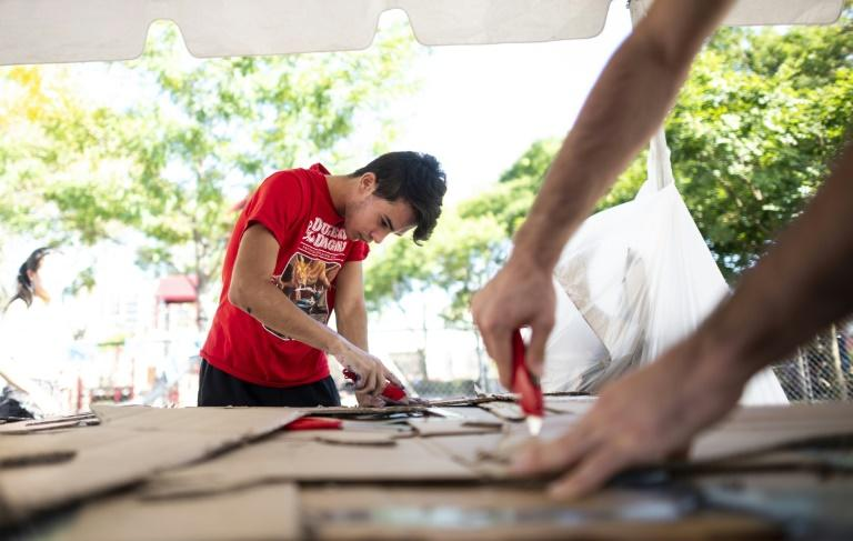 Elijah Gutierrez, 17, works on signs for the September 20 protest