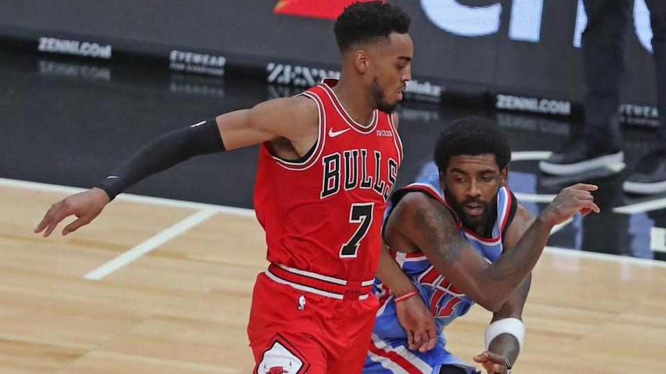 Kyrie Irving gets bodied by Bulls defender throwback jersey