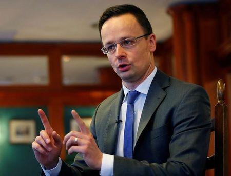 Hungarian Foreign Minister Szijjarto gestures during an interview with Reuters in Budapest