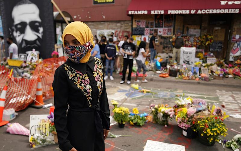U.S. Rep. Ilhan Omar, along with members of the United States Congressional Black Caucus, on Thursday, June 4, when they visited the site where George Floyd died - Anthony Souffle/AP