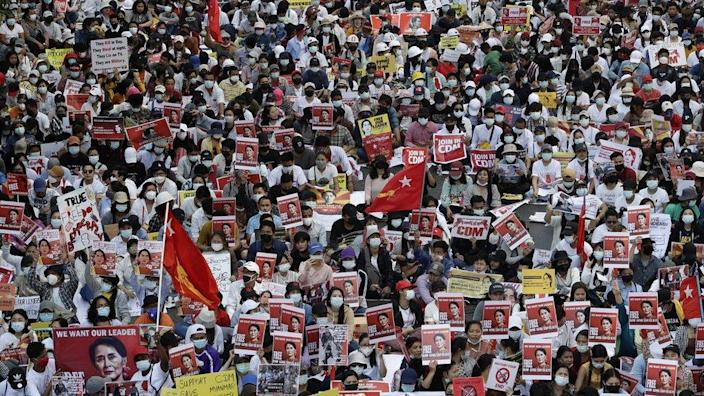 Demonstrators hold placards calling for the release of detained Myanmar State Counselor Aung San Suu Kyi
