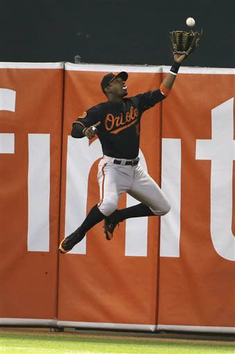 Baltimore Orioles center fielder Adam Jones catches a fly ball hit by the Oakland Athletics' Jed Lowrie during the fourth inning of their baseball game Friday, April 26, 2013 in Oakland, Calif. (AP Photo/Eric Risberg)