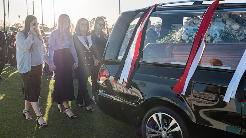Danny Frawley's wife and daughters, pictured here following his hearse.