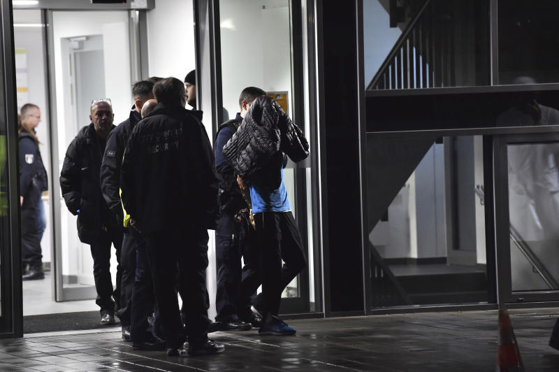 In this Tuesday, Nov. 19, 2010 photo a man is arrested by the police at a hospital in Berlin, Germany. Fritz von Weizsaecker the son of former German Richard von Weizsaecker president has been killed while he was giving a lecture at a hospital in Berlin where he also worked as a physician. (Paul Zinken/dpa via AP)